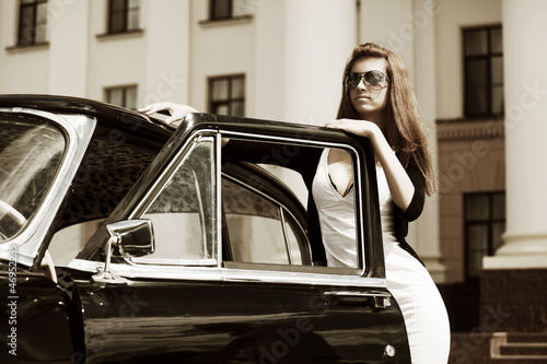 Young woman with retro car