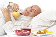 elderly man in a hospital bed eating