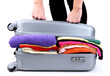 Girl tries to close the suitcase isolated on white