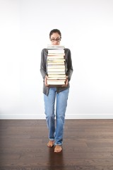 woman with a pile of books