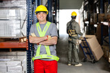 Mid Adult Foreman With Arms Crossed At Warehouse
