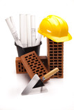 Brick, yellow hard hat, tools