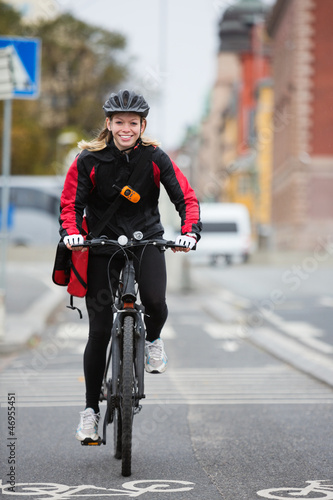 Female Cyclist With Courier Delivery Bag