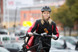 Female Cyclist With Courier Bag On Street