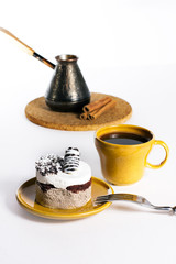 Tasty dessert on the round plate with cup of coffe