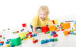 Child happy playing blocks toys over white