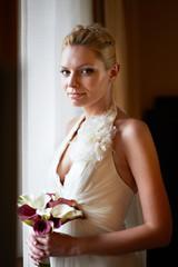 Happy bride with bouquet of calla