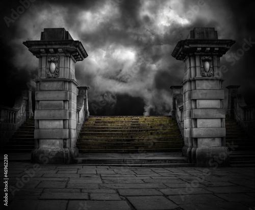 Spooky old sandstone graveyard entrance - 46962280