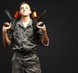Portrait Of Soldier Holding Gun