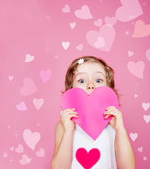 Preschool girl holding paper heart