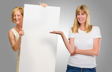 Two Woman Presenting Placard