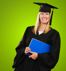 Happy Graduate Woman Holding a notebook