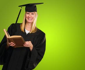 Happy Graduate Woman Holding Book