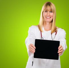 Happy Doctor Showing Digital Tablet