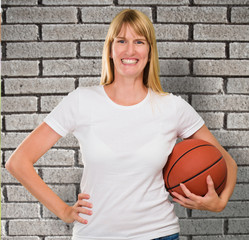Happy Woman Holding a basket ball