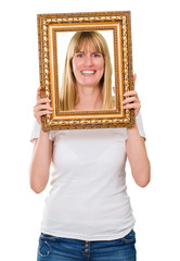 Portrait Of A Happy Woman Holding Frame