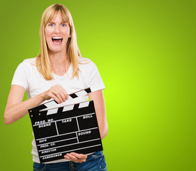 pretty woman holding a clapper board