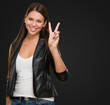 Young Woman Giving Victory Sign