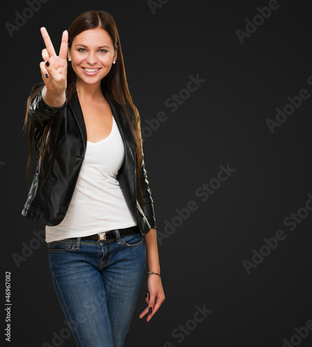 Beautiful Woman Giving Victory Sign