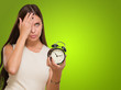 Tired Woman Holding Alarm Clock