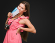 Young Woman Holding Boarding Pass And Camera