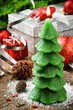 Christmas tree candle on festive background