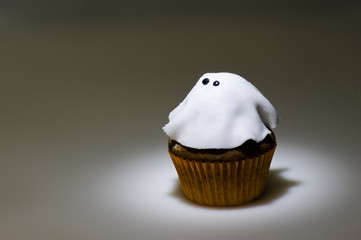 Ghostly cupcake in spot light