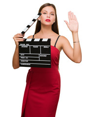 Young Woman Holding Clapper Board
