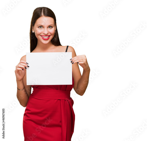 Beautiful woman holding a blank placard