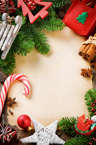 Frame with Christmas tree branches and vintage festive decoratio