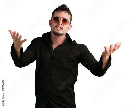 Smart man wearing sunglasses and gesturing