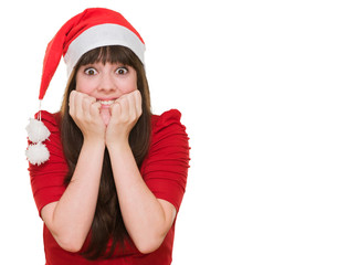 Extremely excited woman wearing a christmas hat