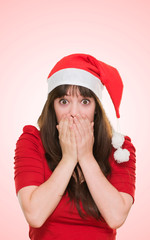 surprised christmas woman covering her mouth