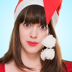 confused woman wearing a christmas hat