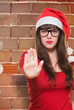 christmas woman doing a stop gesture