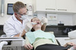 A male dentist treating a female patient