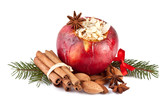 baked apple with fir branch isolated on white