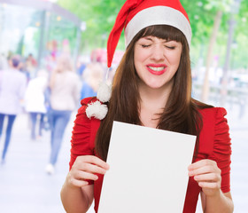 upset christmas woman holding a blank card