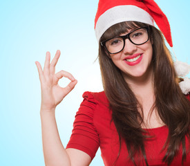 christmas woman doing an ok gesture