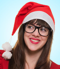 happy christmas woman wearing glasses and looking to a side