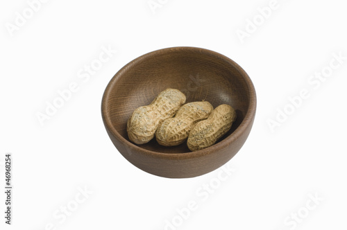Peanut in wooden bowl
