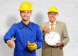 Architect Gesturing In Front Of Engineer Holding Clock
