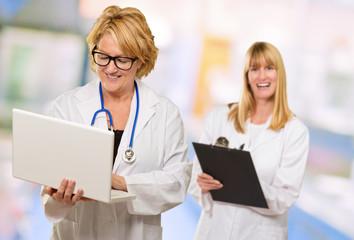 Portrait Of Two Happy Female Doctors