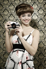 Retro style. Smiling girl with camera