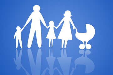 Closeup of paper family on blue background