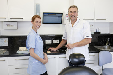 A dentist and dental nurse in a dental surgery
