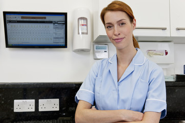 A female dental nurse in a dental surgery