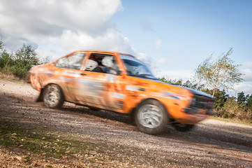 speeding rally car motion blur