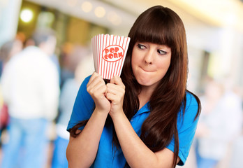 girl holding empty popcorn packet