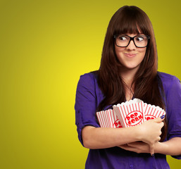 Woman Holding Empty Popcorn Packet